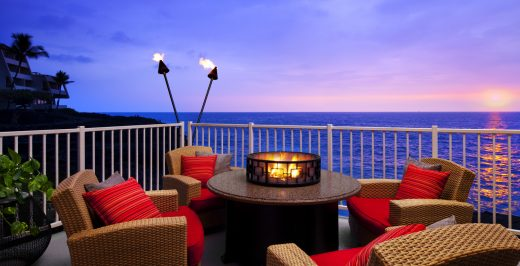 firepit with brown wicker armchairs
