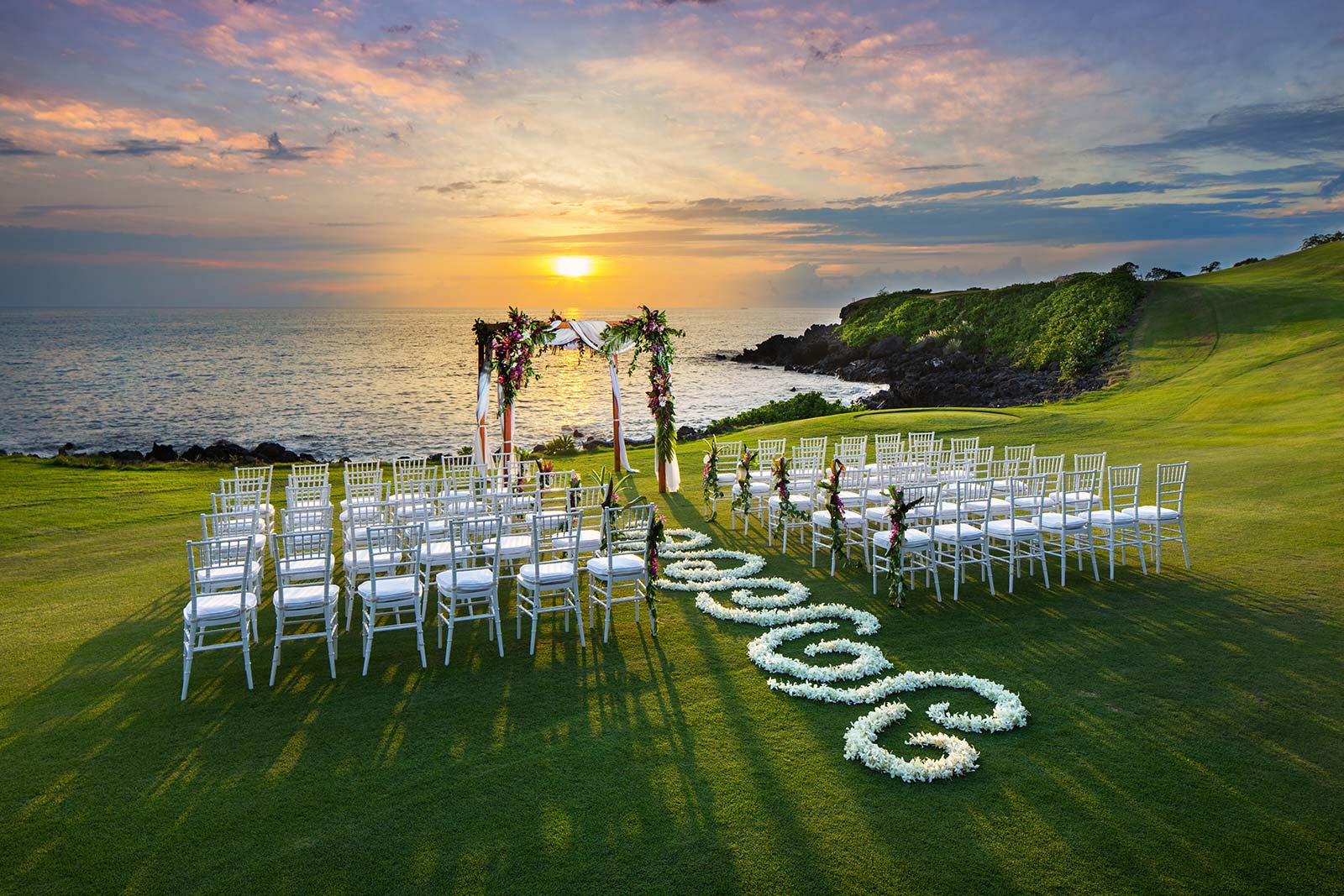 wedding reception during sunrise over ocean view